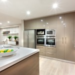 Modern kitchen area illuminated with lights at night